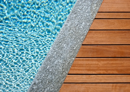 natural pool: Water, stone and wood divided by a diagonal Stock Photo