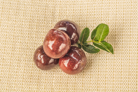 shine: shine red plums with leaf Stock Photo