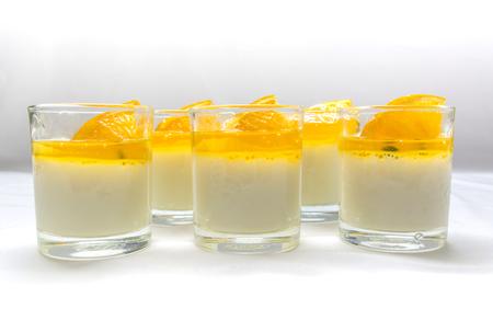 jams: yogurt penna cotta with orange and passion fruit jams in glassware on white tone background Stock Photo