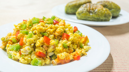 scramble: To eat eggs every morning with mixed vegetable scramble egg and spinach bread