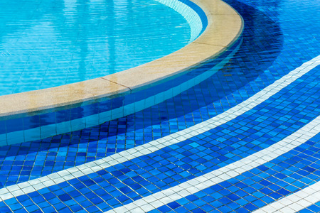 water wave: soft focus water surface, sun light reflect, water wave outdoor swimming pool Stock Photo