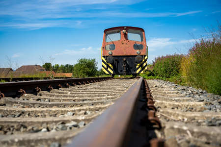 Siding - An old red diesel shunter on a dead track.