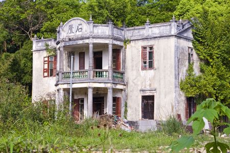 Deserted chinese mansion house Stock Photo