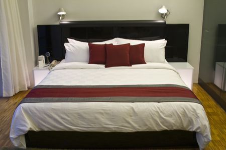 hotel stay: Luxury hotel room bed Stock Photo