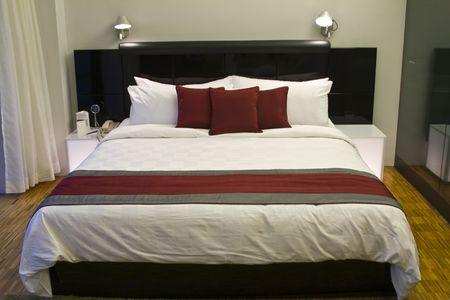 Luxury hotel room bed Stock Photo
