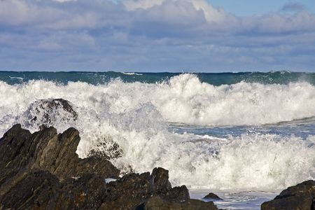 Stormy sea with waves braking on the rocks