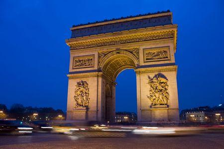 Arc De Triomphe in Paris France at night Stock Photo