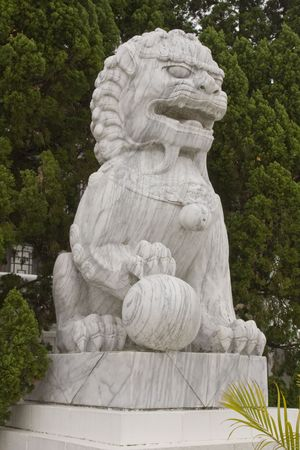 Chinese Lion stands guard at a temple in Taiwan Stock Photo