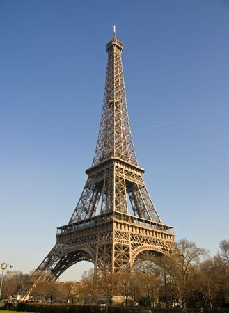 Eiffel Tower in Paris France with a bright blue sky