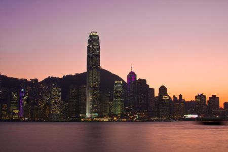 Hong Kond Island skyline at dusk with a red and purple sunset Stock Photo