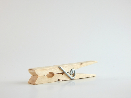 This is a picture of a clothespin on a white background. Stock fotó