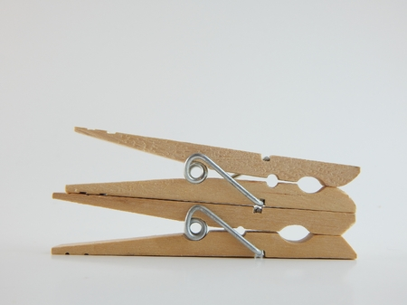 This is a picture of clothespins on a white background. Stock Photo