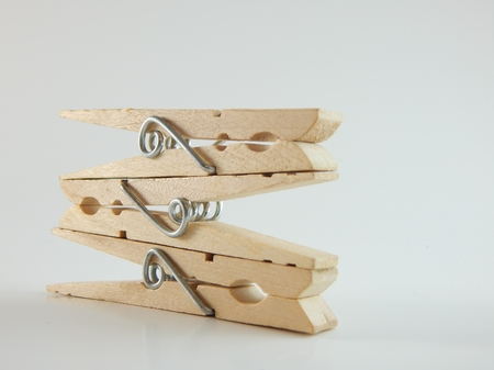 This is a picture of clothespins on a white background. Stock fotó