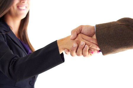Cropped image of two business executives shaking hands after a deal over white background. Horizontal shot. photo