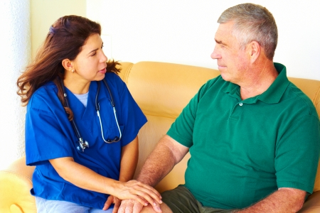 Home healthcare of a nurse taking care of senior man photo