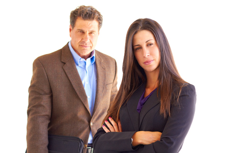 Confident young businesswoman with male colleague over white background. Horizontal shot. photo