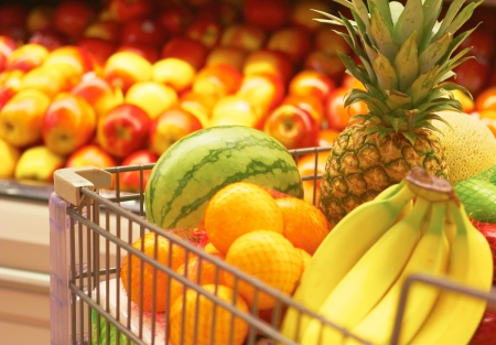 Shopping Cart Full Of Fruit at the supermarket. Selective Focus, Grocery Shopping for fruit. photo