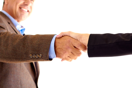 Cropped image of two businesspeople shaking hands over white background. Horizontal shot. photo