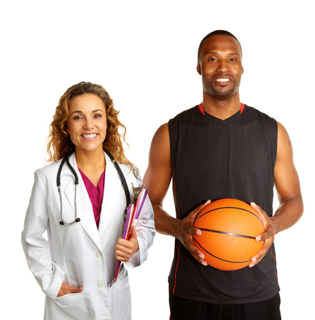 Sports doctor with basketball player isolated on white background photo