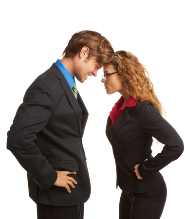 rivalry: business rivalry competition between business man and woman butting heads isolated on white background. Stock Photo