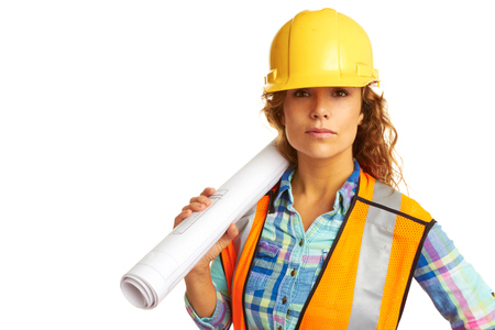 female construction worker: Serious female construction worker isolated on white background.