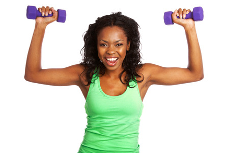 Happy beautiful female exercising with weights isolated on white background. photo