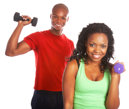 Happy african american male and female back to back exercising with weights isolated on white background. photo