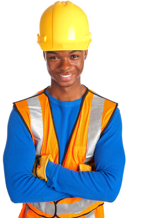 happy african american construction with arms crossed isolated on white  photo