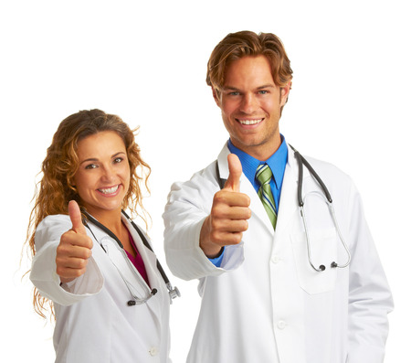 attractive female and male doctor giving approval isolated on white photo