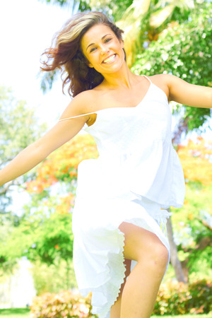 jovial: Portrait of jovial young woman with beautiful smile dancing. Vertical shot.