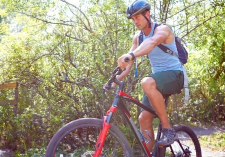 mountain biking: Young man mountain biking on trail