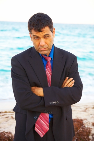 business man at beach after losing his job depressed and worried. photo