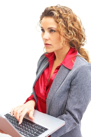 social worker: beautiful serious business woman holding laptop isolated on white . Copy space, color image, white . Stock Photo