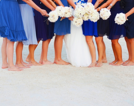 bridesmaid: A bride and her bridesmaids holding flowers at beach in Key West Florida