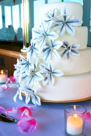Wedding Cake With Flowers And Candle. Vertical Shot, color image photo