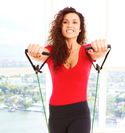 Beautiful female doing resistance training with copy space. photo
