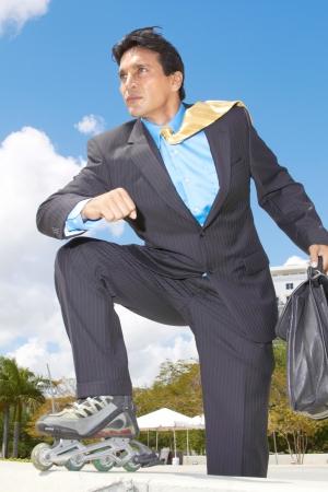 energy work: Businessman rollerblading with briefcase in urgency at park. Vertical shot.