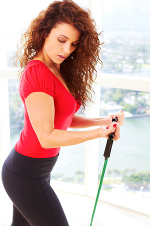 resistance: Beautiful female doing resistance training with copy space.