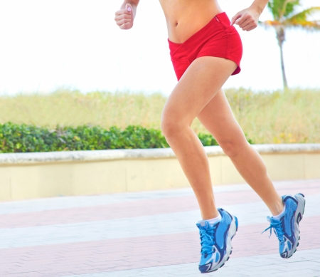 body concern: Low section of a fitness woman jogging early morning. Horizontal Shot. Miami Beach, Florida.