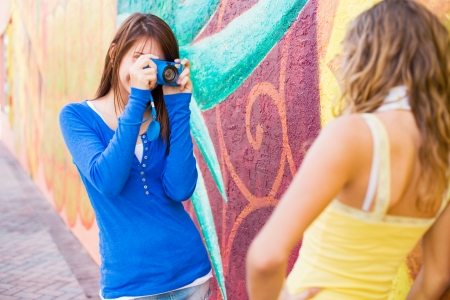 Happy cute  teenage girls taking pictures photo