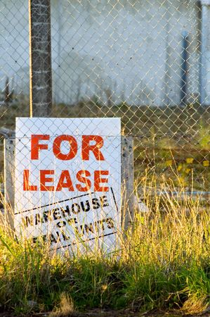 slowdown: A For Lease Sign on a vacant, part developed piece of land.  Space for copy.