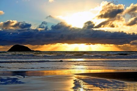 A beautiful sunset at Maori Bay, Muriwai,  on the west coast of Auckland, New Zealand