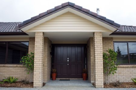entranceway: A modern house entranceway and front door Stock Photo