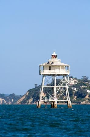 Bean Rock Lighthouse, in the Hauraki Gulf, Auckland, New Zealand photo
