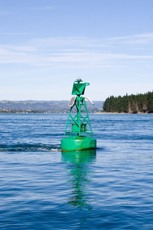 A green starboard hand marker buoy in the Tauranga Harbour Stock Photo - 9072343