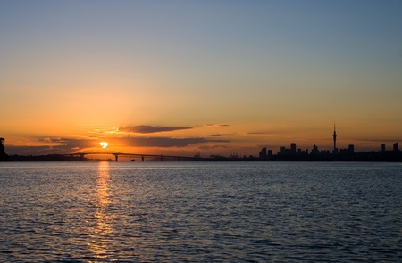 A stunning sunrise over Auckland Harbour Bridge, Auckland City, New Zealand photo