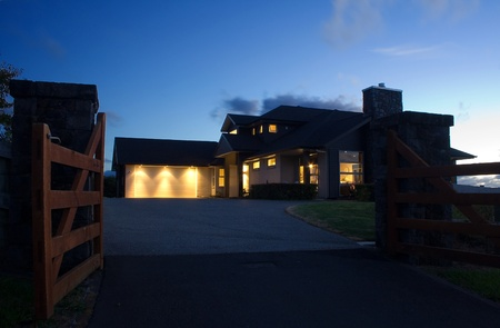 A modern house exterior at night photo