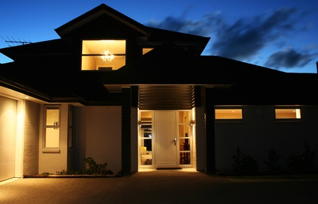 residence: A modern house front entrance at night Stock Photo