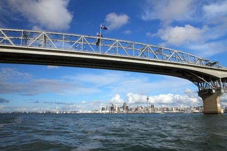sky scraper: Auckland Harbour Bridge with Auckland City and Sky Tower in the background, New Zealand viewed from the water