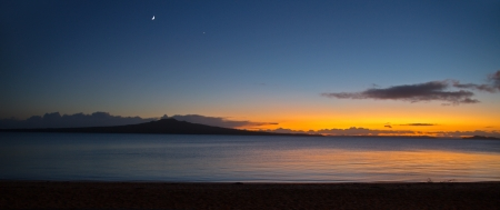 new zealand beach: A panoramic view of a new day as the sun rises behind Rangitoto Island, Auckland, New Zealand